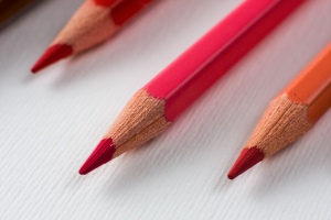 Three sharp red pencils.